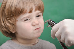 Small child and dental instrument Stock Photo