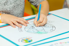 Small child draws with colored pencils Stock Photo