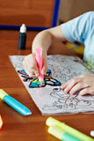 Small child draws pink paint for Stained Glass royalty free stock photos