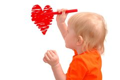 Small child draws red heart Royalty Free Stock Photos