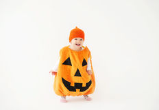Small child dressed as a pumpkin for Halloween. Child dressed as a pumpkin for Halloween stock image