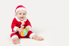 Small child dressed as Santa Claus. With a bright ball Stock Photos