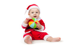 Small child dressed as Santa Claus. With a bright ball Royalty Free Stock Images