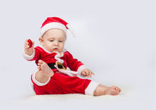 Small child dressed as Santa Claus. 