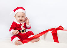 Small child dressed as Santa Claus white background. Small child dressed as Santa Claus Royalty Free Stock Image