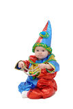 A small child dressed in a clown costume stock images