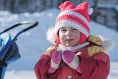 A small child is drinking a hot drink in winter Royalty Free Stock Photography