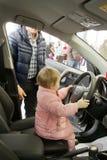 Small child drove the car. KALININGRAD, RUSSIA – MARCH 02, 2014: Small child drove the car on Toyota presentation royalty free stock photography