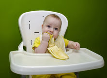 A small child is eating a banana Royalty Free Stock Image