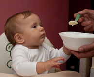 Small child eating lunch and smiling Royalty Free Stock Photos