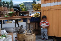 Small child in an Ecuadorian market stock images
