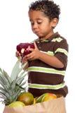 Small Child Enjoying Tasty Apple stock image