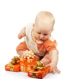 Small child with gifts. Isolated on white stock photography