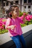 Small Child girl Holdling Flower Stock Images