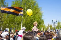 A small child on his father`s shoulders. May 9, victory day. St. George`s ribbon royalty free stock photography