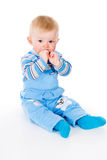 A small child his hands to his mouth Stock Image