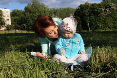 Small child and his mom outdoor. In summer day Stock Image