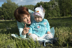 Small child and his mom outdoor. In summer day Stock Images