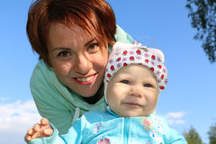 Small child and his mom outdoor. In summer day Stock Photography