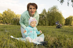 Small child and his mom outdoor. In summer day Royalty Free Stock Images