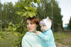 Small child and his mom outdoor. In summer day stock photos