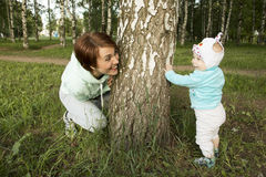 Small child and his mom outdoor. In summer day royalty free stock photo
