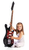 Small child hold red acoustic guitar. Music Stock Images
