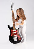 Small child hold red acoustic guitar. Music Stock Photos