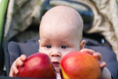 Small child holding both hands two apples Stock Images