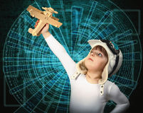 Small child holding a plane, high technology, the development of Royalty Free Stock Images