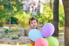 A small child holds in hands balloons Royalty Free Stock Photo