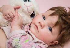 A small child hugs the toy. royalty free stock image