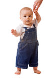 Small child in jeans. With mom's hand Stock Photography