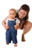 Small child in jeans with mom. In studio Stock Images