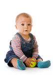 Small child in jeans with tennis ball. Studio shot Stock Image