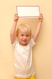 Small child keeps tablet in hands Royalty Free Stock Photo