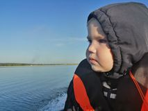 A small child in a life jacket stock photo