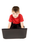 A small child looks into the notebook computer Stock Image