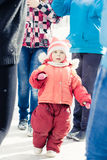 Small child lost in a crowd of strangers. In winter Royalty Free Stock Image