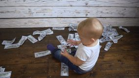 Child and a lot of money. A small child and a lot of money stock video
