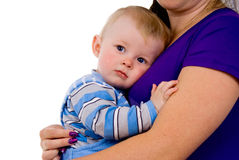 A small child lying on the breast of his mother stock images