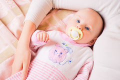 Small child lying by its mother Stock Photography