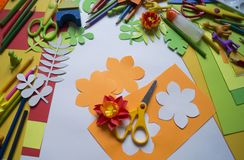 Girl draws. Children`s creativity. Favorite hobby for children. Materials and tools. Small child makes paper crafts for mother`s day or birthday. Small child Stock Images