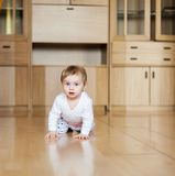 Baby learning to crawl on floor in room royalty free stock photos