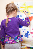 Small child painting with brush and paint Royalty Free Stock Photo