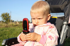 The small child with phone. Stock Image