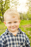 Small child  in a plaid shirt. Stock Photos