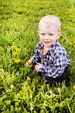 Small child  in a plaid shirt. Royalty Free Stock Images