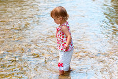 Small child play on the shallow water Royalty Free Stock Photos