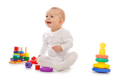 Small child play with toys on white background. Baby play with toys on white background in studio Stock Photography